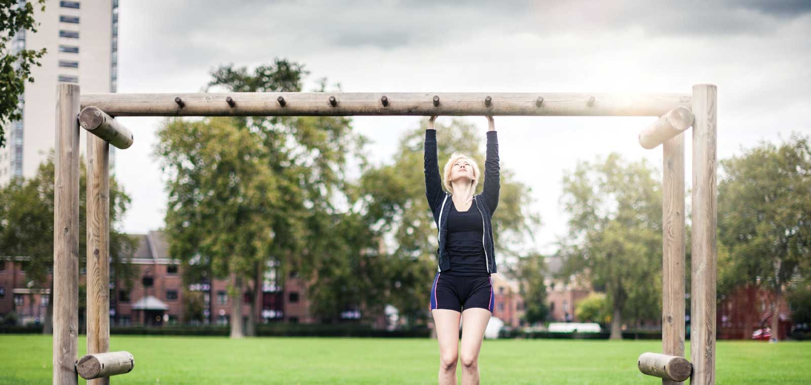 Woman doing Pullup Outside